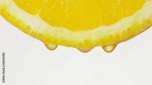 Squeeze out juice. Drops of juice of a citrus.