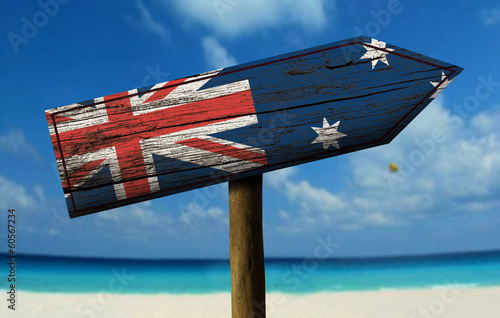 Australia flag wooden sign with a beach on background