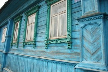 Old wooden painted house with carved decoration, Russia