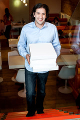 Smart guy holding pizza boxes
