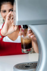 Girl filling glass with chocolate shake