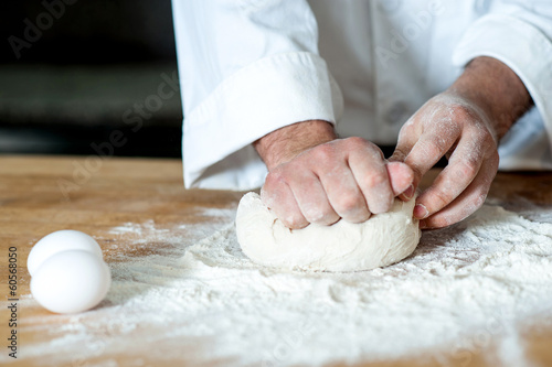 Man kneading dough, closeup shot