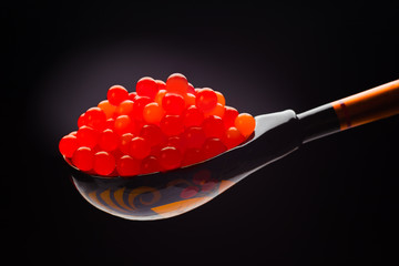 Red caviar on ethnical Russian wood spoon