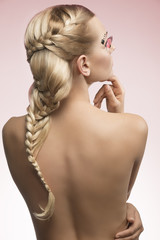 female with nude back and creative hairdo