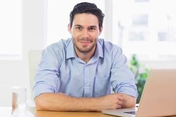 Confident businessman at desk