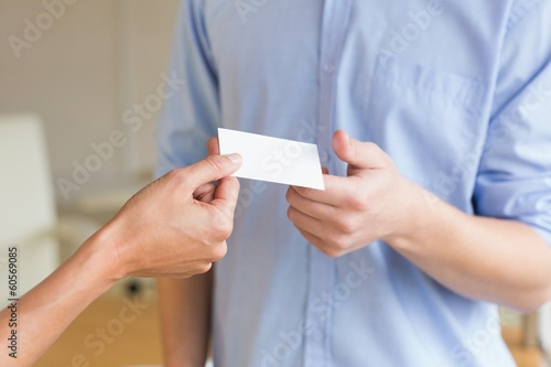 Business people exchanging visiting cards