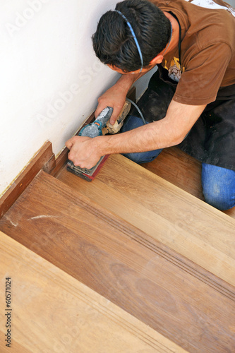 Carpenter working on a wooden stairway