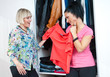 two woman friends choosing clothes