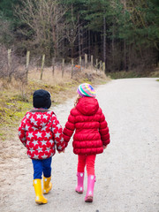 small boy and girl walking hand in hand