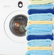 pile of clean towels with washing machine
