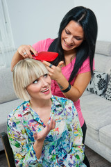 woman combing friends hair