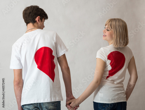 man and woman on Valentine's Day in jeans on a white background