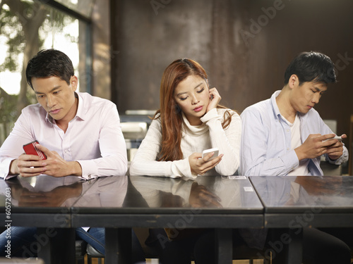 phubbers - people playing with cellphone ignoring each other