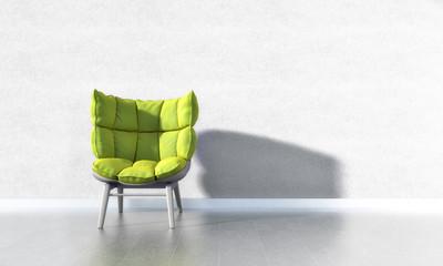 Grüner Sessel vor weißer Wand
