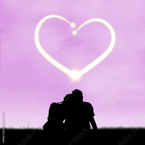 Loving couple under the heart in the sky