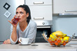 attractive woman drinking juice in the kitchen