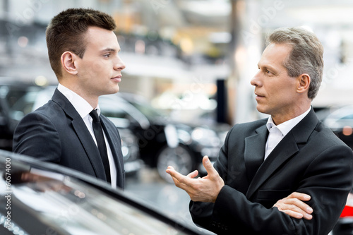 Discussing car features.