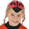 Mädchen mit Marienkäfer-Kappe zu Fasching