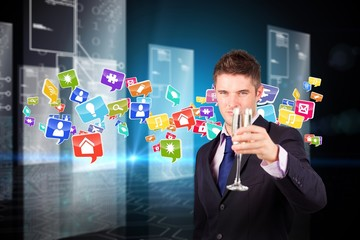 Composite image of businessman holding a champagne glass
