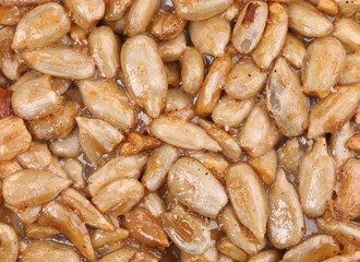 Background of roasted nuts with sugar