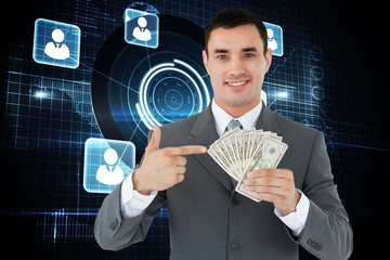 Composite image of businessman pointing at bank notes in his han