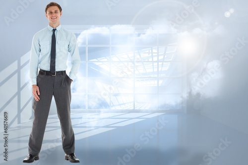 Composite image of smiling businessman standing with hand in poc