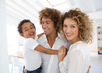 Happy family standing in brand new home