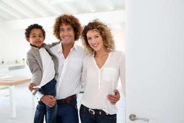 Happy family welcoming people in new home