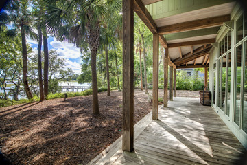 covered porch with waterfront view