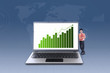 Businessman and increasing bar chart on laptop