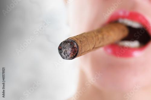 Leinwandbild Motiv woman smoking cigar.