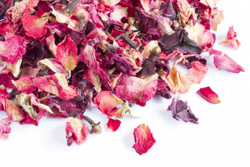 Dried rose petal pot-pourri on a white background
