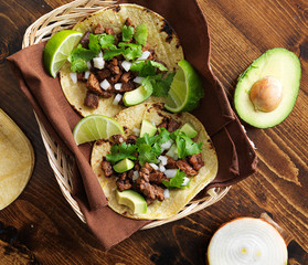 overhead view of two traditional tacos in a basket.