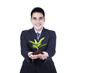 Isolated businessman holding a plant