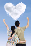 Success couple with heart shape cloud