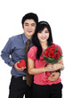 Young couple with gift and flowers