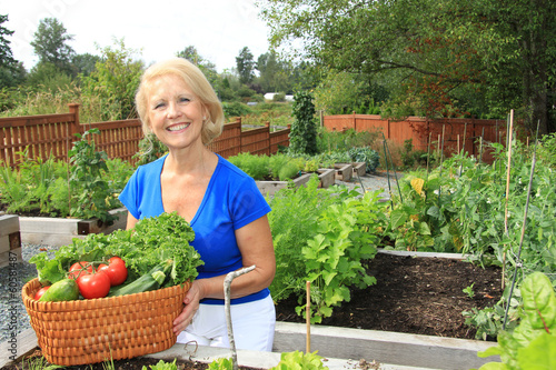 Senior gardener and vegetables.