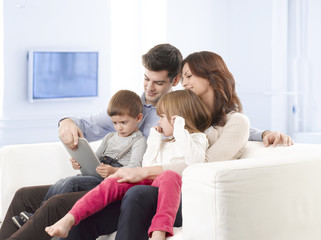 Happy family sitting in living room