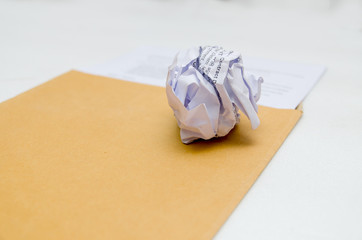 Crumpled paper on envelope