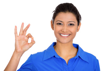 Happy, smiling excited beautiful natural woman giving OK sign