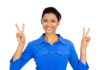 Smiling happy woman peace victory, two sign gesture
