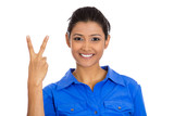 Happy woman giving peace victory, two sign gesture