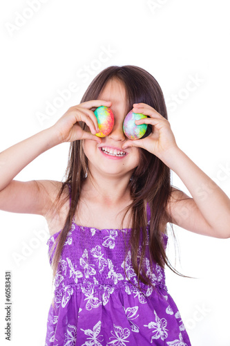 Cute girl keeping two decorated easter eggs