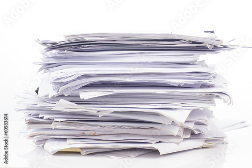 Leinwanddruck Bild Piled up office work papers