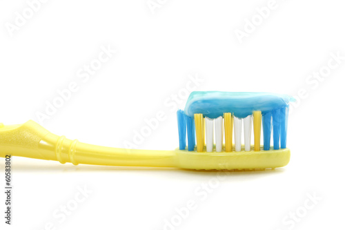 Tooth brush with toothpaste over white background