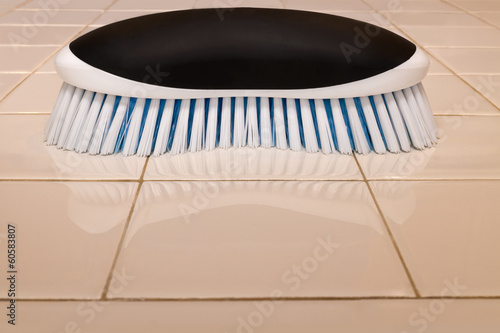 Scrub brush and sparkling clean ceramic tile countertop