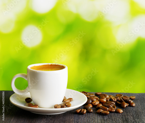 Fotobehang Cafe Cup of coffee on nature background