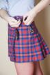 Woman fastening her skirt