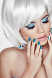 Manicured nails. Professional makeup. Blond woman Portrait. Whit