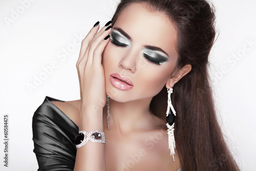 Glamour Fashion Woman Portrait. Elegant girl posing with black m